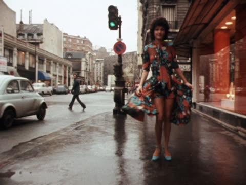 vídeos y material grabado en eventos de stock de model wears a patterned dress over matching shorts. - vestimenta para mujer
