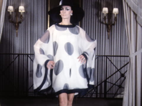 stockvideo's en b-roll-footage met a model wears a pierre balmain polka dot cape dress - stippen