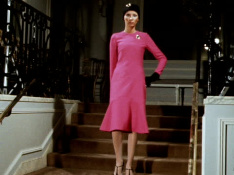 A model wears a pink dress designed by Dior