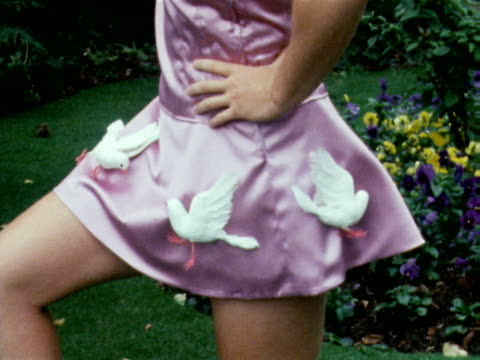 A model wears a pink satin tennis dress with white doves designed by Teddy Tinling June 1969
