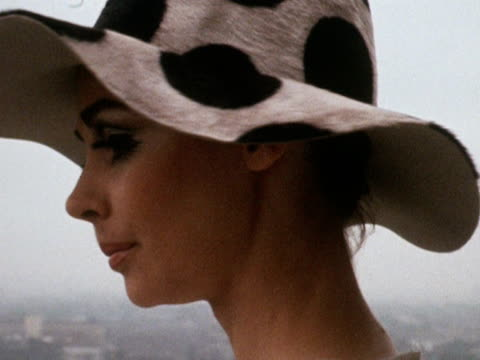 stockvideo's en b-roll-footage met a model wears a polka dot hat 1968 - stippen