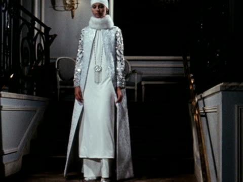 vídeos y material grabado en eventos de stock de model wears a silver and white bridal outfit with a white mink collar, designed by marc bohan for house of dior. - vestimenta para mujer