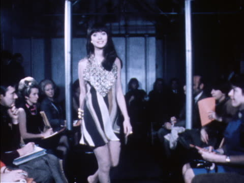 a model wears a striped mini dress with metal detail at a paco rabanne fashion show - fashion collection stock videos & royalty-free footage