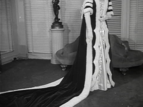 A model wears a traditional gown worn by peeresses attending Coronation ceremonies