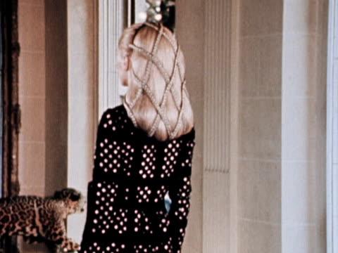vídeos de stock e filmes b-roll de a model wears a tudor style evening dress and hair net - tudor