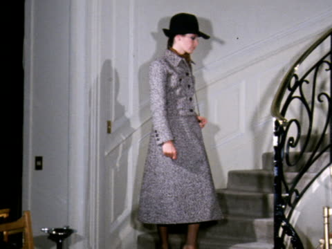 model wears a tweed skirt and jacket with a fedora hat designed by yves saint laurent. - saint laurent stock videos & royalty-free footage