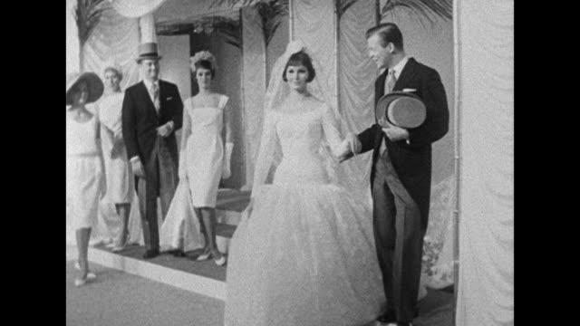 vídeos de stock, filmes e b-roll de a model wears a wedding dress during a fashion show organised by the fashion house group of london - dama de honra