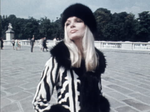 a model wears a zebra print coat with fur trim and matching hat - zebramuster stock-videos und b-roll-filmmaterial