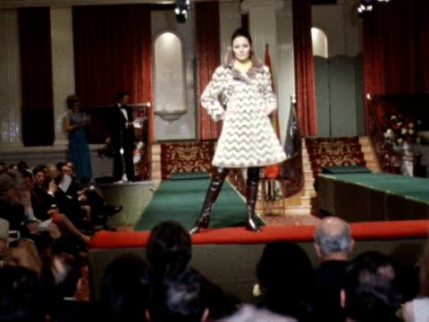 a model wears a zigzag patterned coat and black boots during a fashion show - zigzag stock videos & royalty-free footage
