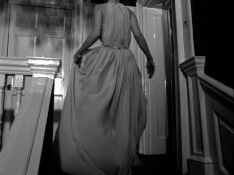 vídeos y material grabado en eventos de stock de model wears an evening gown designed by hardy amies. 1961. - vestimenta para mujer