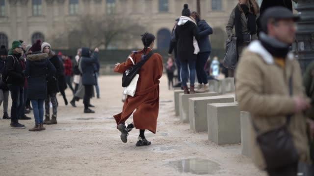 A model wears an orange long coat a white turtleneck during Paris Fashion Week Menswear F/W 20192020 on January 20 2019 in Paris France