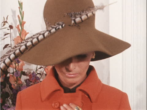 a model wears an orange suit with a dark blouse and feathered hat designed by worth - blouse stock videos & royalty-free footage