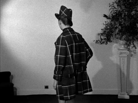 a model wears tartan bermuda shorts and a matching jacket and hat designed by paterson - tartan stock videos & royalty-free footage