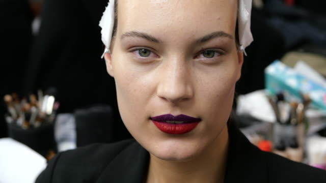 model with make up done is seen during the make up at miaoranbackstage fashion showduring milan fashion week fall/winter 2020/2021 on january 13... - beautician stock videos & royalty-free footage