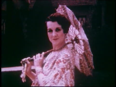 1929 model with parasol + flowered dress posing outdoors - parasol stock videos & royalty-free footage