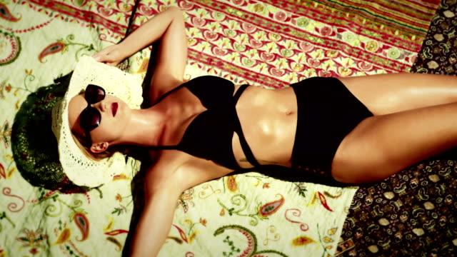 model woman is sunbathing top view - bikini top stock videos & royalty-free footage