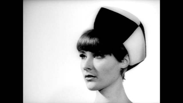 models adorned with coiffure hair styles while looking over the french landscape / model wearing checker hat / models in hats in museum gallery /... - kunst, kultur und unterhaltung stock-videos und b-roll-filmmaterial
