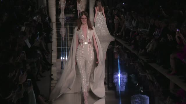 Models and designer Zuhair Murad on the runway for the Zuhair Murad Haute Couture Fashion Show in Paris on January 27 2016 in Paris France