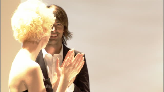 CU ZO MS Models applauding designer on catwalk, then walk backstage / London, England, UK