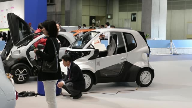 Models demonstrate the UniCub B a new personal mobility device at the 43rd Tokyo Motor Show 2013 in Tokyo Japan on Thursday Nov 21 The Subaru...