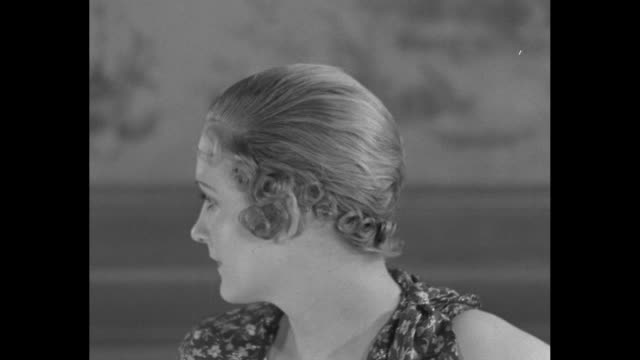 vs models display hair styles for short hair created by antoine of paris which feature curls lacquered to the scalp / models in hats fitted over curls - 1932 stock videos & royalty-free footage