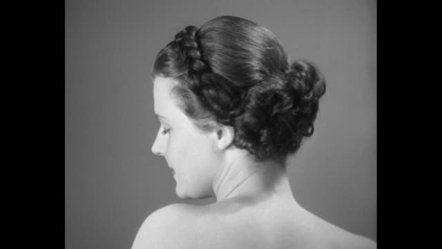 models display rose laird hairstyles: grecian, victorian, spanish, and debutante; a women smokes a cigarette /notes: exact day not known; nitrate... - braided hair stock videos & royalty-free footage