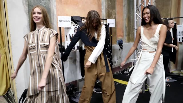 Models fool around backstage ahead of the Ujoh show during Milan Fashion Week Spring/Summer 2019 on September 23 2018 in Milan Italy