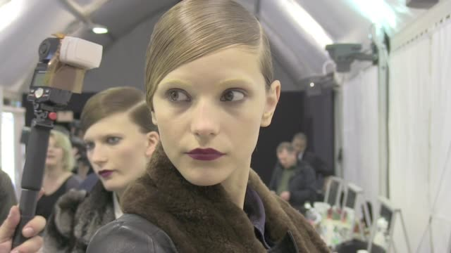 Models getting ready backstage during the Guy Laroche ReadyToWear Fall/Winter 2012 show as part of Paris Fashion Week at Espace Ephemere...
