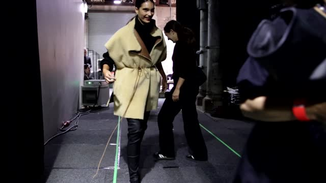 models hurry to remove their boots before the next run backstage during of the bassike winter collection 2021 show at afterpay australian fashion... - carriageworks stock videos & royalty-free footage