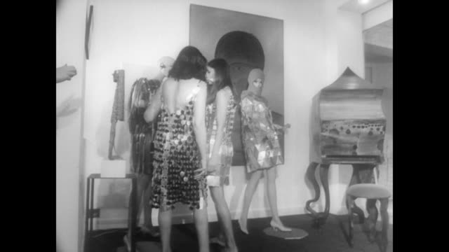 models in art filled room with sparkly flapper style dresses / models touch and talk about mannequins wearing similar dresses / take leather... - headdress stock videos & royalty-free footage