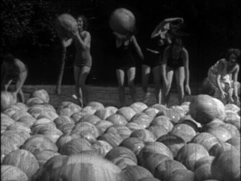 b/w 1926 models in swimsuits frolicking  + throwing rubber balls / newsreel - 1926 stock videos & royalty-free footage