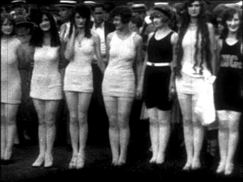 PAN models in swimsuits standing in outdoor beauty contest/ newsreel