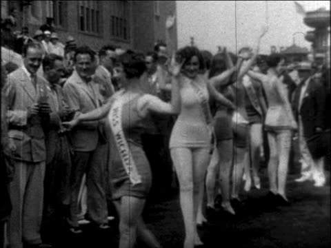 b/w 1926 models in swimsuits walking past camera in outdoor beauty contest / newsreel - 1926 stock videos & royalty-free footage