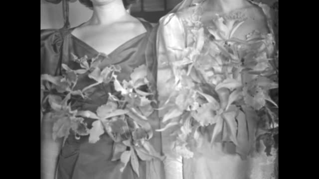 vídeos de stock, filmes e b-roll de vs models in wedding and bridesmaid dresses posing for camera in front of mirrors doors dressing rooms and walking many hold bouquets / note exact... - bridesmaid