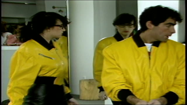 models in yellow leather jackets looking into mirror - jacket stock videos & royalty-free footage