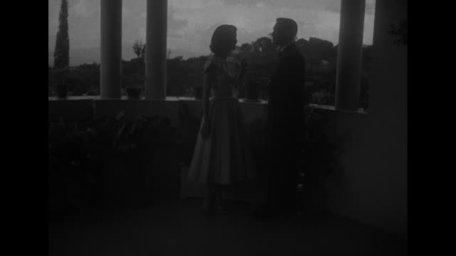 models louise and lionel stand under covered overlook with columns, lionel lights louise's cigarette - column stock videos & royalty-free footage