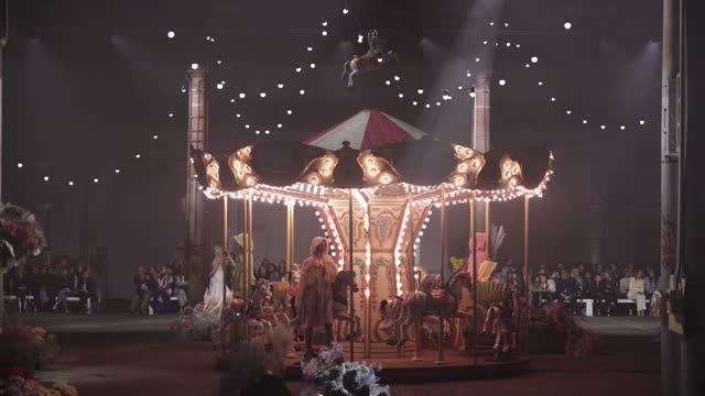 models pose on a merry-go-round in the middle of the runway during the romance was born show during afterpay australian fashion week 2021 resort '22... - fashion show stock videos & royalty-free footage