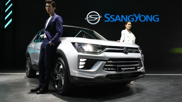 models poses next to a ssangyong korando at the seoul motor show 2019 at kintex on march 28 2019 in goyang south korea the seoul motor show 2019 will... - goyang stock videos and b-roll footage