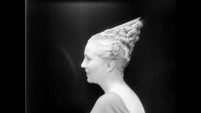 models turn heads slowly to show off streamline coiffure hairstyle / group of women display all hairstyles streamline hair styles of the 1930s on... - 1935 stock-videos und b-roll-filmmaterial