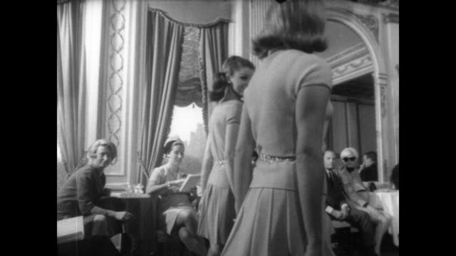 models walk in new york wearing austrian designs / seated audience watches as models walk along in pairs / marvienne wool ensemble / franz kugler... - austrian costume stock videos and b-roll footage