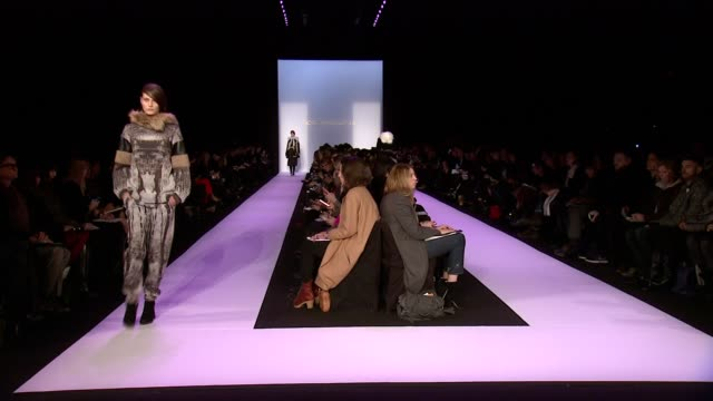 stockvideo's en b-roll-footage met models walk the runway at bcbg max azria fall 2014 mercedesbenz fashion week at the theatre at lincoln center on in new york city - bcbg max azria