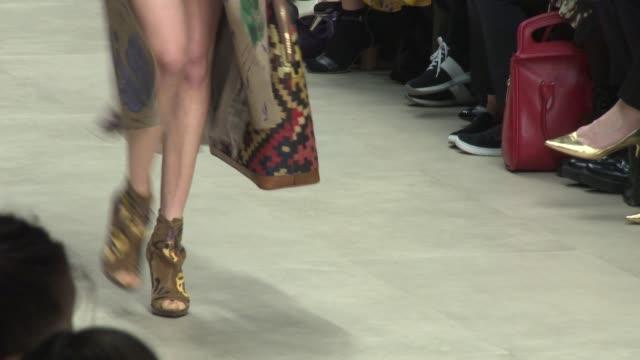 Models walk the runway at Burberry Prosum A/W14 London Fashion Week at Kensington Gardens on February 17 2014 in London England
