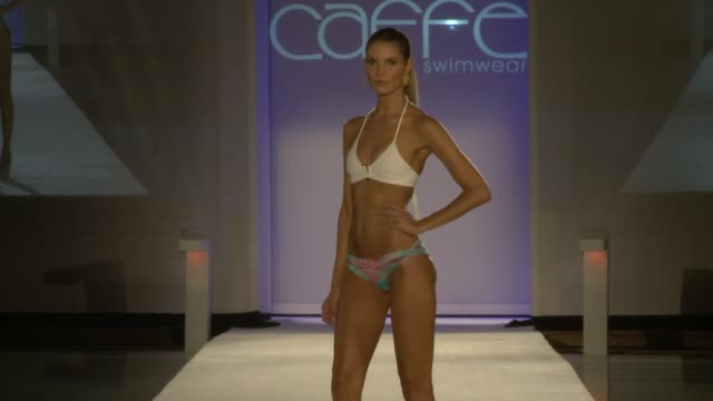 Models walk the runway at Caffe Swimwear SS16 Collection at SWIMMIAMI Runway at FUNKSHION Tent on July 18 2015 in Miami Florida