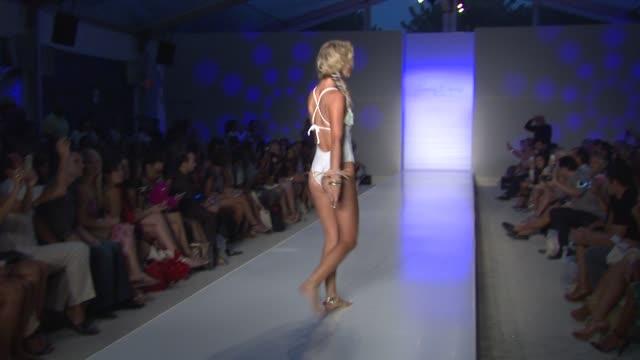 Models walk the runway at Frankie's Bikinis MercedesBenz Fashion Week Swim 2015 at Oasis at the Raleigh Hotel on July 18 2014 in Miami Florida