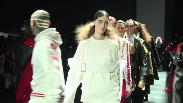 vídeos y material grabado en eventos de stock de models walk the runway at hood by air - nyfw - womens f/w 2016 at the arc, skylight at moynihan station on february 14, 2016 in new york city. - vestimenta para mujer
