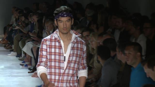 stockvideo's en b-roll-footage met models walk the runway at michael bastian s/s 2016 nyfw mens runway show at skylight clarkson sq on july 15 2015 in new york city - skylight clarkson sq