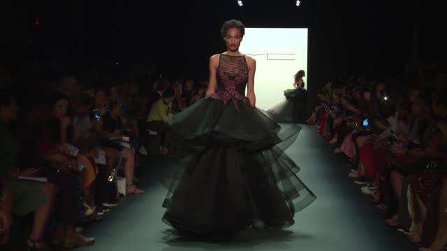 stockvideo's en b-roll-footage met models walk the runway at michael costello september 2016 new york fashion week at the dock skylight at moynihan station on september 08 2016 in new... - moynihan station
