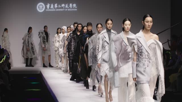 models walk the runway at the chongqing university of education show during the 2021 china graduate fashion week on may 17, 2021 in beijing, china. - デザイナー服点の映像素材/bロール