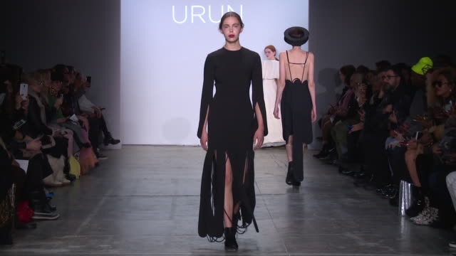 stockvideo's en b-roll-footage met models walk the runway at turkish designers runway february 2019 new york fashion week the shows at industria on february 12 2019 in new york city - new york modeweek