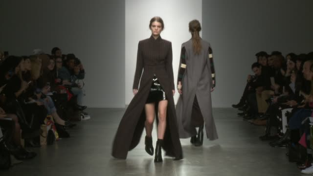 models walk the runway during kaal e.suktae - 2015 f/w collection-new york fashion week at pier 59 on february 12, 2015 in new york city. - 既製服点の映像素材/bロール
